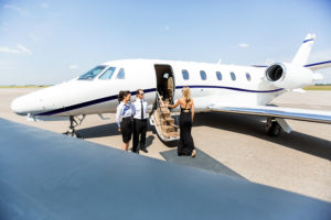 Woman using airport transportation service with chauffeurs